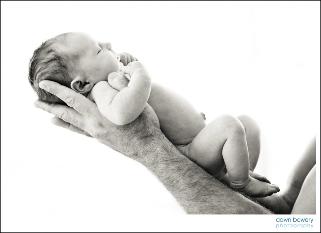 Los Angeles creative Newborn Portrait Photographer baby on arm